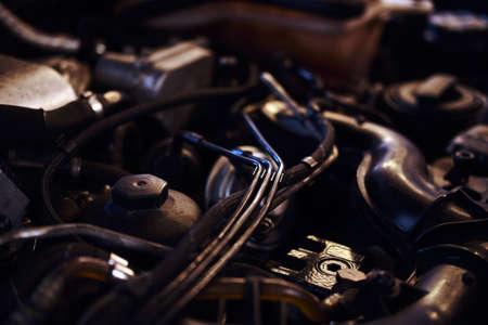 Closeup photoshoot of open cars engine at expirienced car service workshop. Stock Photo