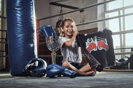 Little kid is winning her first match at boxing club and got prises for it.