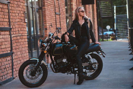 There are mature beautiful woman in sexy bikers clothing, she got her dramatic style.
