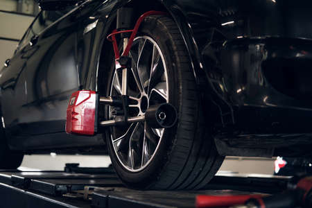 Tyres balancing in progress - new shiny car got problems with wheels. Stok Fotoğraf - 130637014