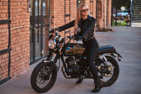 There are mature beautiful woman in bikers clothing, she got her dramatic style. Stock Photo