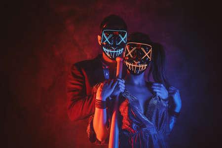 Couple wearing masks close up.