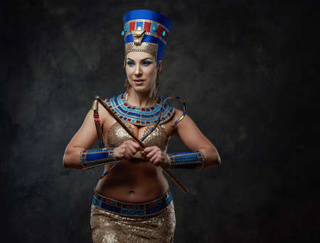 Woman in egyptian costume with distinctive attributes of power
