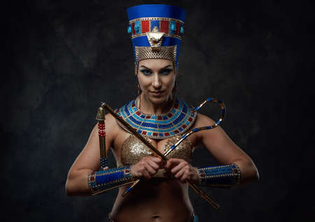 Beautiful woman in egyptian blue and gold costume with some red details Stock fotó