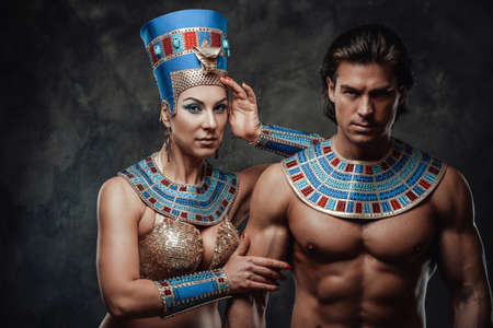 Beautiful woman in traditional egyptian costume with her arm laid on male shoulder. Stock fotó