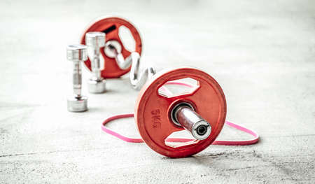 Healthy lifestyle and body care is important thing and herere some sportive stuffs for it. Dumbells and barbell of floor with cord.