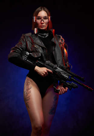 Brown haired female mercenary dressed in black jacket and posing with and tattooed legs. Portrait of a beautiful martial woman in cyberpunk style with glasses and short haircut.