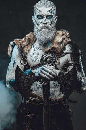 Nordic warlike undead with hatchet in smokey background Stock fotó