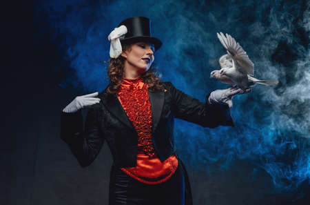 Female perfomer dressed in classic retro clothing posing with doves