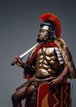 Empire soldier dressed in fur and armor holding sword Foto de archivo
