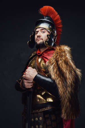 Military roman with fur against dark background Stock Photo