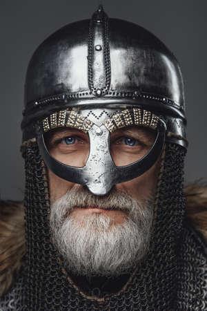 Closeup portrait of elder viking warrior with helmet