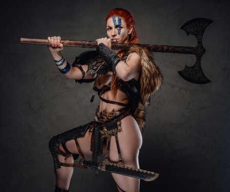 Redhead valkyrie from nord with axe on her shoulder in dark background