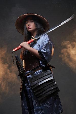Japanese woman assassin with bamboo hat and katana
