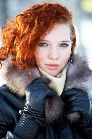 freezing: winter portrait of a beautiful woman freezing
