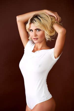 Young attractive female model posing in underwear in a studio