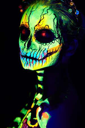 UV body art painting of helloween female skeleton