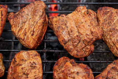 Chiken barbeque on a grill roasting open fire spring summer time outdoors