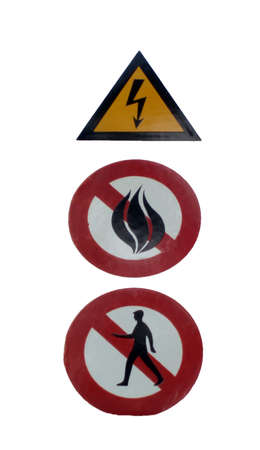 forbids: Three alert signs. First one warns against electricity, second one forbids fire a third one entrance.