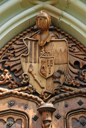 buckler: Door carving with medieval knight coat-of-arms