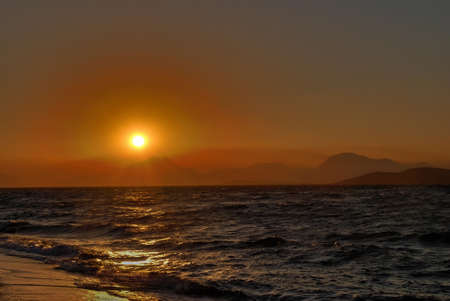 Sun is setting behind the mountains and sea Stock Photo - 1545689