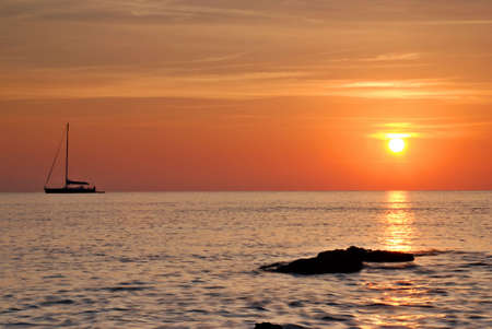 Sailing boat silhouette and  sunrise photo