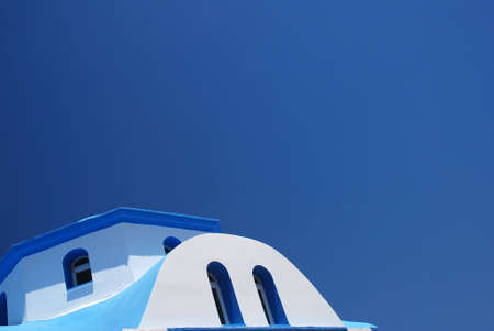 Roof of a Greek church against the blue sky  photo