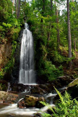 Waterfall in the forest with a long exposure photo