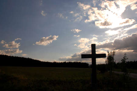 Christian cross during the sunset photo