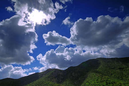 Sun is shining through the clouds in the mountains Stock Photo - 2299824