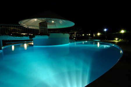 outdoor lighting: Swimming pool at night illuminated by lamps