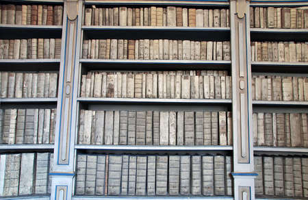 Library shelves with ancient medieval medical books photo