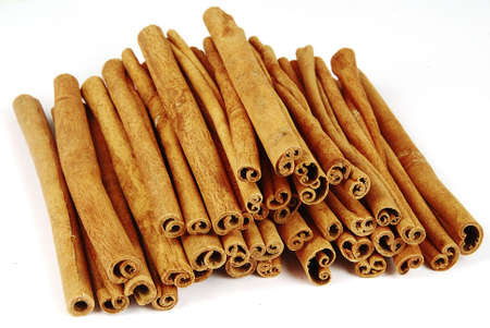 Big pile of spicy cinnamon sticks isolated Stock Photo - 2491286