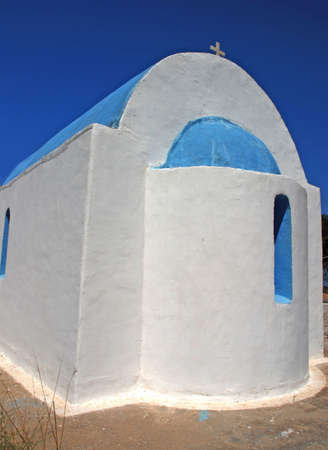 ortodox: Typical Greek church - white walls and a blue cupola