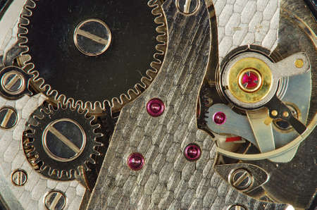 Mechanism of old clock - sprockets and ruby gems in the system are well visible photo