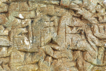 Ancient Sumerian writing carved in the stone  photo
