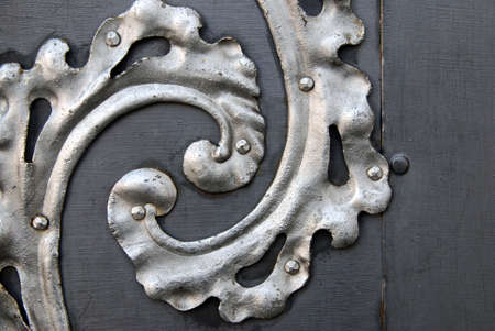 Detail of a ancient metal door with spiral silver decoration Stock Photo - 2632583