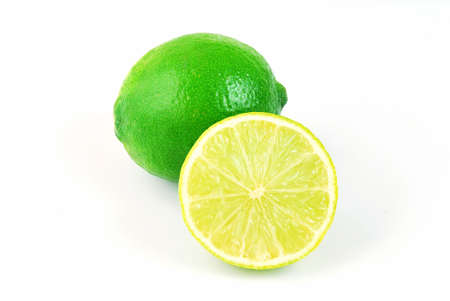 vitamines: Fresh green lime full of vitamines isolated on light background