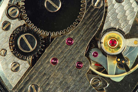 calibre: Mechanism of old clock - sprockets and ruby gems in the system are well visible Stock Photo