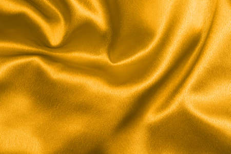 Beautiful and shiny golden satin background - for luxury designs Stock Photo - 2691255