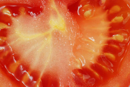 lycopene: Macro of a fresh sliced tomato. Good for vegetable background