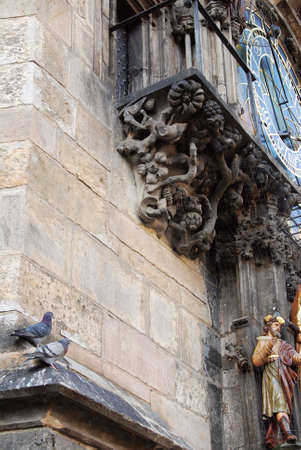 Astronomical clock in Prague and a pair of pigeons
