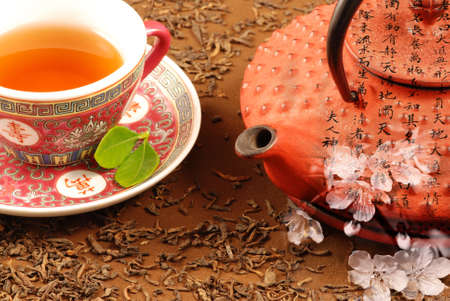 Special Chinese tea ceremony with kettle, calligraphy and cherry bloom photo