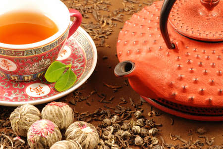 Traditional Chinese tea ceremony with kettle, cup and various kinds of tea photo