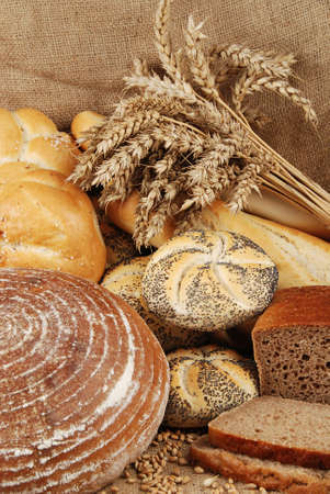baked  goods: Various fresh baked goods with wheat grain and bundle Stock Photo