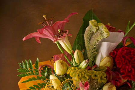 Detail of a beautiful bouquet on brown background photo
