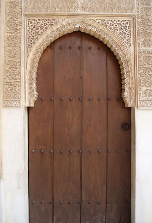 moorish: Beautiful portal wirth closed door to the ancient palace Alhambra in Spain