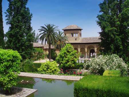 Paradise on the Earth - palace of Alhambra with gardens in Granada, Spain  Editorial