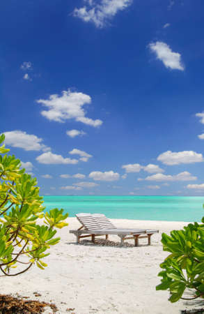 Relaxing in the maldives, deck-chair and the azure sea  Stock Photo