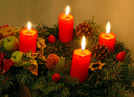 Christmas wreath with four red burning candles photo